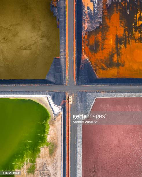 four tailing ponds at a gas plant as seen from directly above, western australia - western australia stockfoto's en -beelden