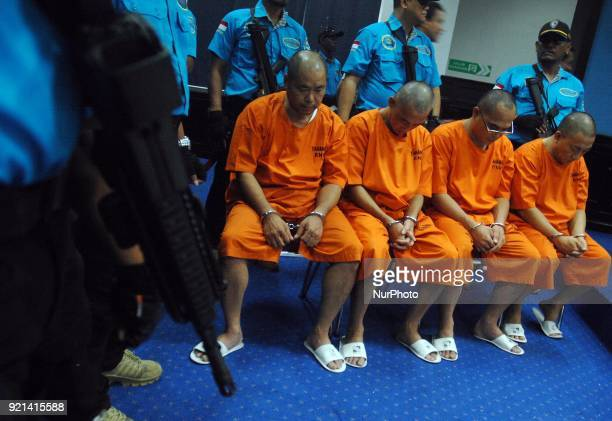 Four Taiwanese detainees who were arrested due to smuggling 1375 tons of methamphetamine are seen at The National AntiNarcotics Agency of Indonesia...