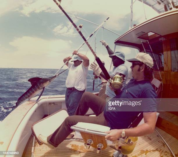 Four team members participating in the Hemingway Memorial Tournament in Cuba in 1978 haul a marlin aboard their sport fishing boat