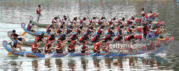 Four teams row their dragon boats during a race in Taipei on June 13 2010 in celebration of the Dragon Boat Festival which falls on June 16 The...