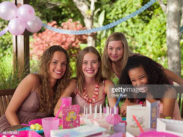 four teenage girls at birthday party smiling outdoors - teenagers only stock pictures, royalty-free photos & images