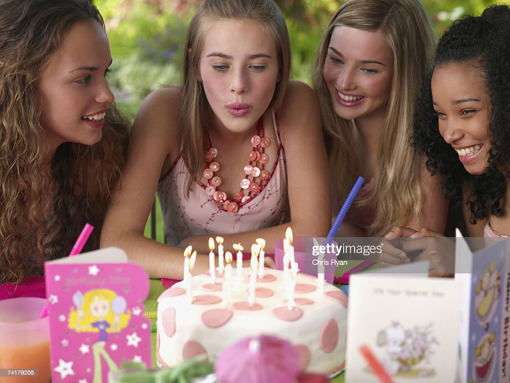 Four teenage girls at birthday party smiling outdoors : Stock Photo