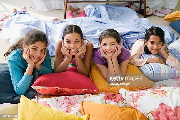 Four teenage girls at slumber party