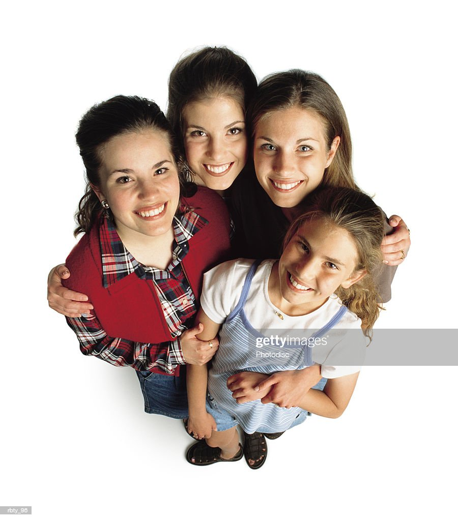 four teenage girls casually dressed gather together as they look up toward the camera : Foto de stock