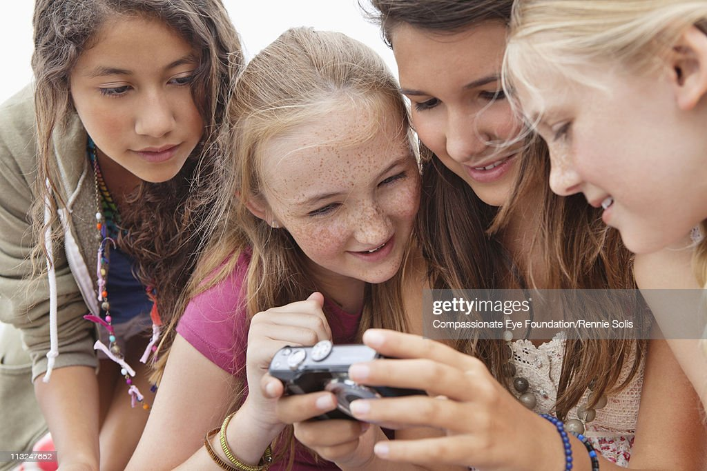 Four teenage girls looking at camera : Stock Photo
