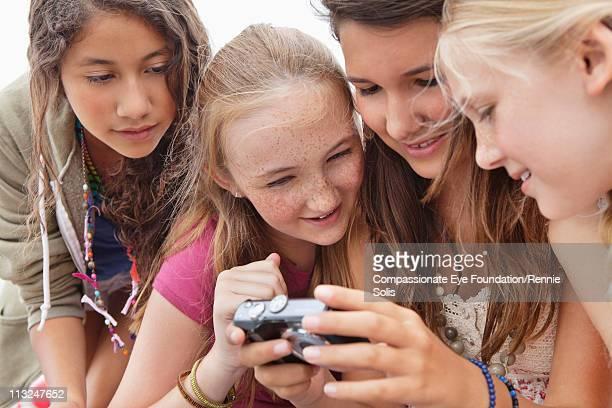 Four teenage girls looking at camera