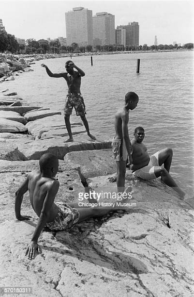 Four teens diving from the rocks at the point 55th along lakefront nineteenth or twentieth century