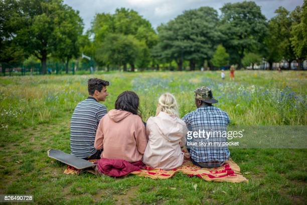 Four teens in the park.
