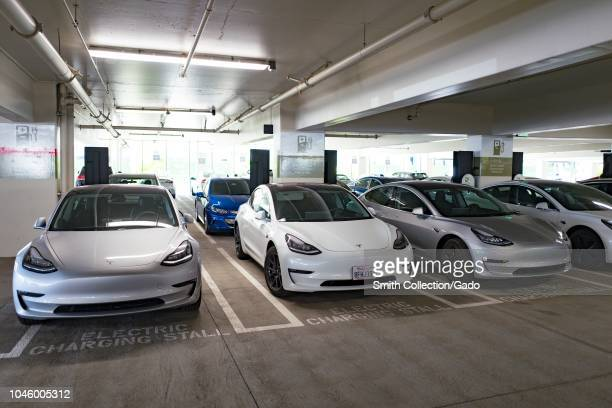 Four Tesla Model 3 electric cars from Tesla Motors are visible charging at an electric vehicle charging station in San Ramon California September 26...
