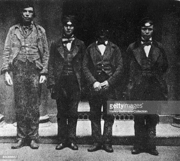 Four thieves and pickpockets in police custody in Glasgow circa 1865 From left to right James Martin Lindsay James Brown Cummings Peter Hasson and...