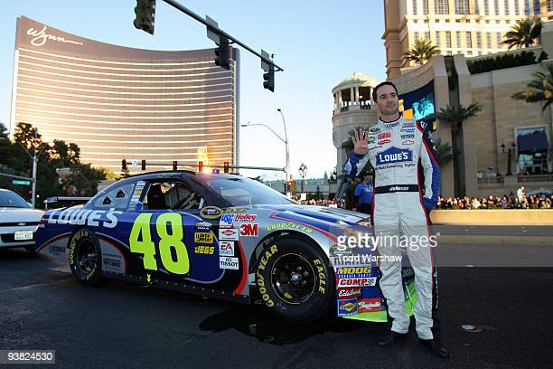 Four time NASCAR Sprint Cup Champion Jimmie Johnson driver of the Lowe's Chevrolet poses next to his car in front of the Wynn Las Vegas during the...