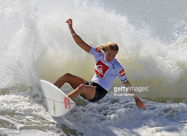 Four time world champion Stephanie Gilmore rides the waves during an exhibition round at the Quiksilver Pro New York tournament on September 9 2011...