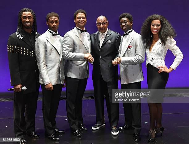 "Four Tops member Duke Fakir poses with cast members Jordan Shaw Daniel Bailey Brian James Leys ""Duke"" Fakir Samuel Edwards Lucy St Louis of the West..."