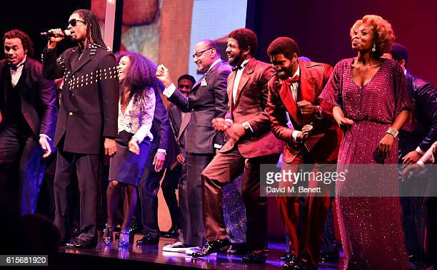 Four Tops member Duke Fakir poses with cast members of the West End production of Motown The Musical at The Shaftesbury Theatre on October 19 2016 in...