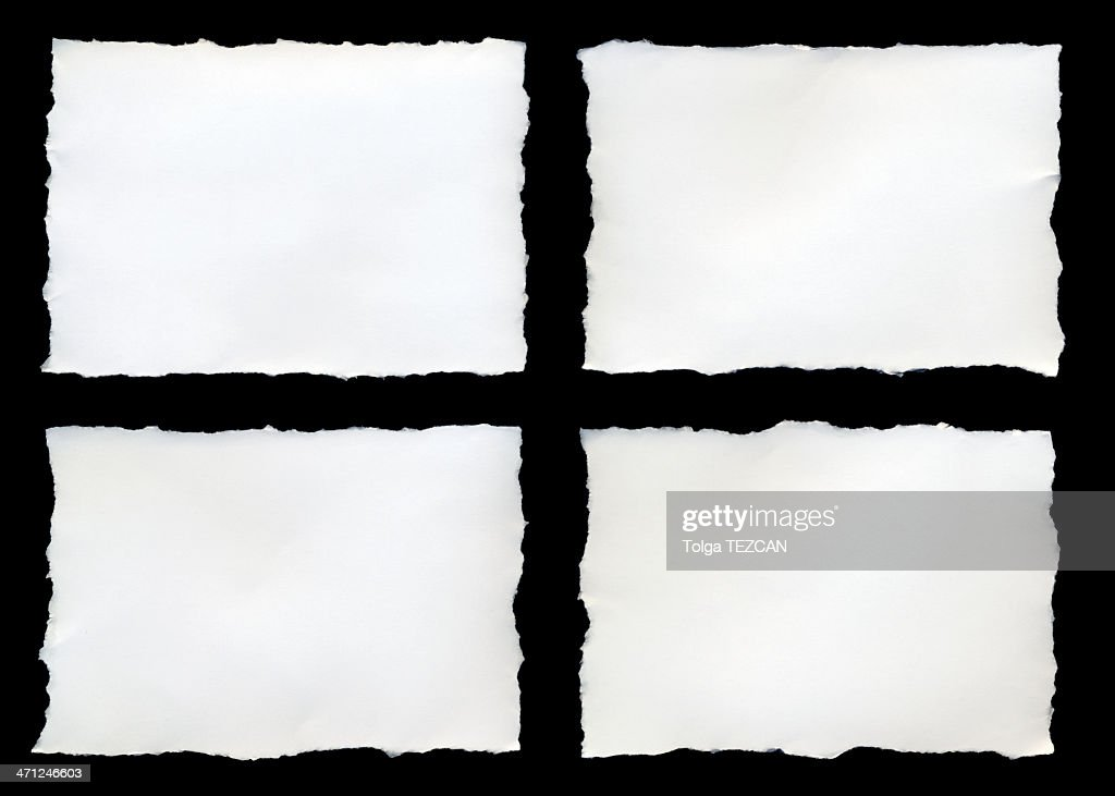 Four torn pieces of paper on a black background : Stock Photo