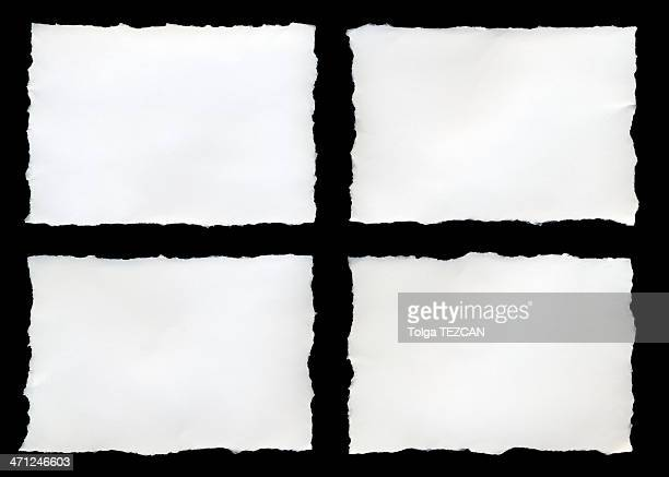 Four torn pieces of paper on a black background