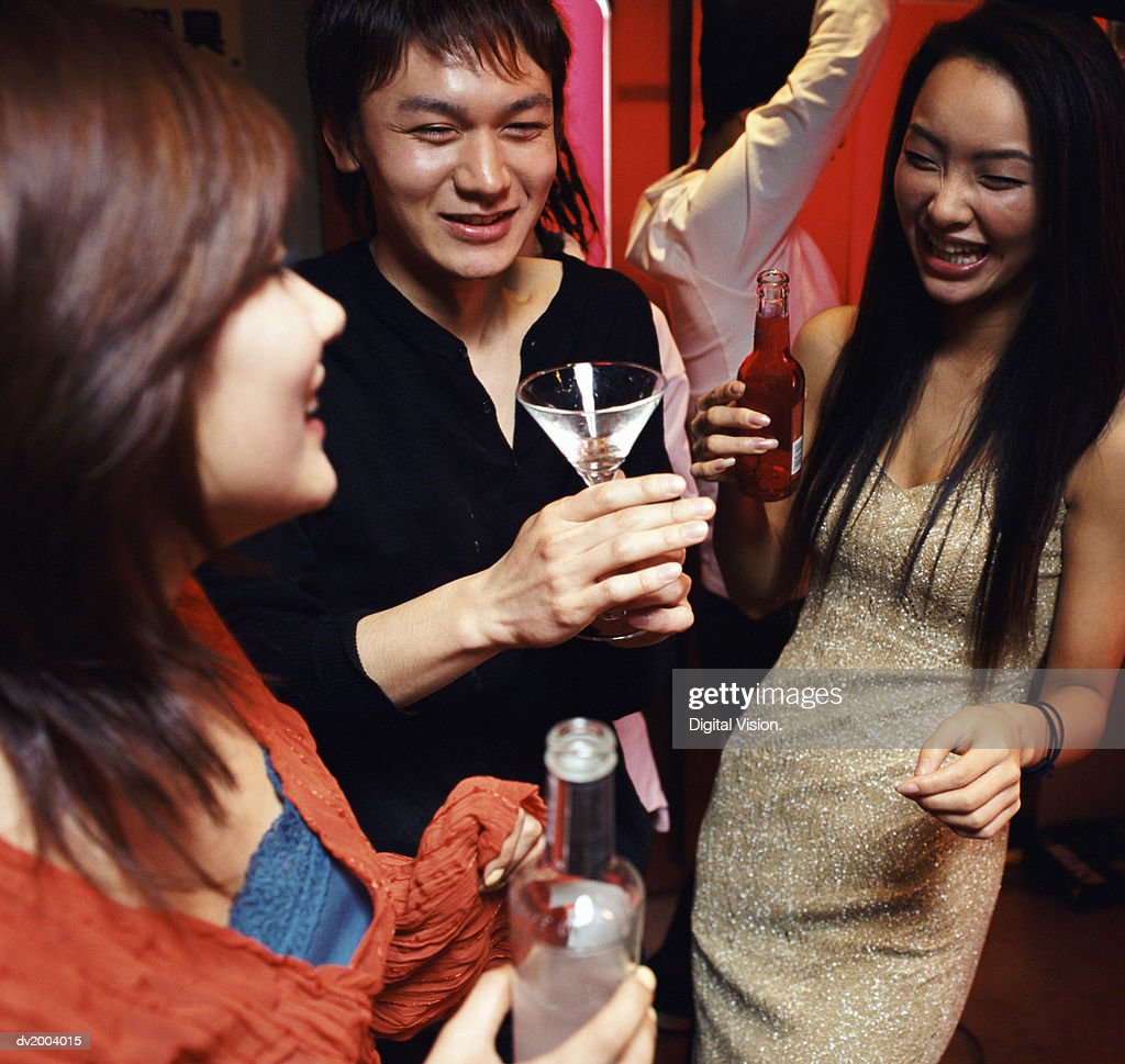 Four Twentysomethings Having Fun in a Bar : Stock Photo