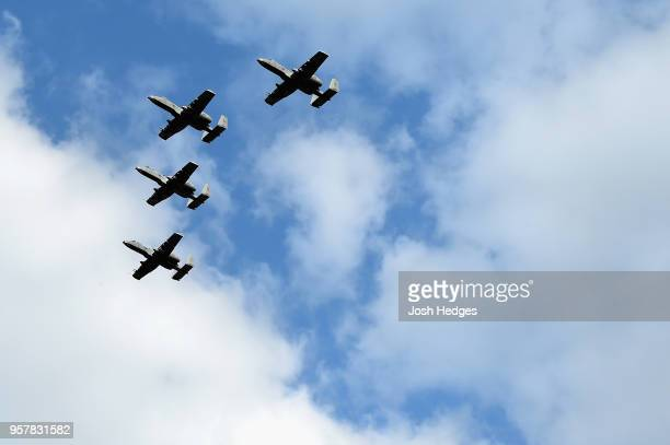 Four United States Air Force A10 Warthogs fly over the track during the national anthem prior to the Monster Energy NASCAR Cup Series KC Masterpiece...