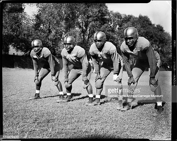 Four University of Pittsburgh football players from left halfback Chester Rice fullback Bobby Epps quarterback Henry Ford and end Bill Adams posing...