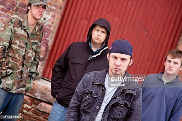 four urban gang members - gang stock pictures, royalty-free photos & images