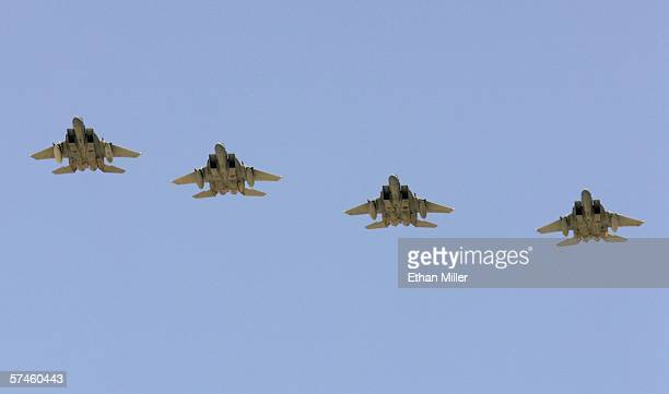 Four US Air Force F15 aircraft fly over Nellis Air Force Base while participating in the Joint Expeditionary Force Experiment 2006 April 25 2006 in...