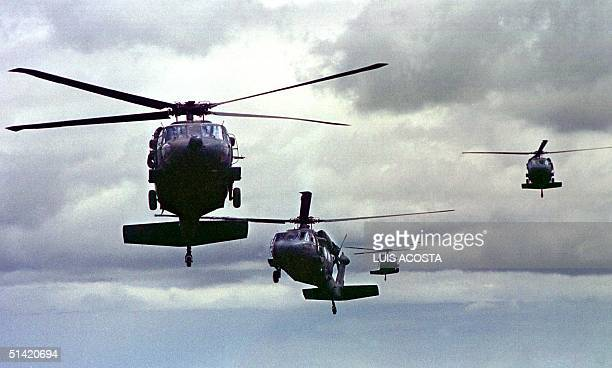 Four USbuilt Blackhawk helicopters arrive at the airport near Neiva Colombia southeast of Bogota 13 July 2000 The helicopters are part of a...