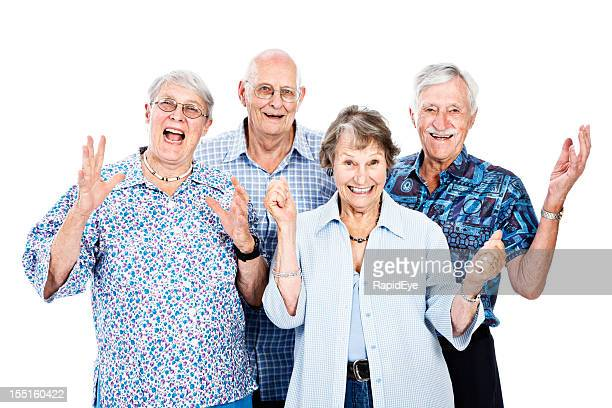 Four very positive, supportive seniors smile and wave