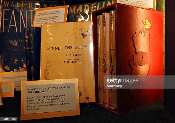 A four volume set of first edition copies of WinnieThePooh by AA Milne sit on display in the Bauman Rare Books booth at the 52nd Annual Winter...