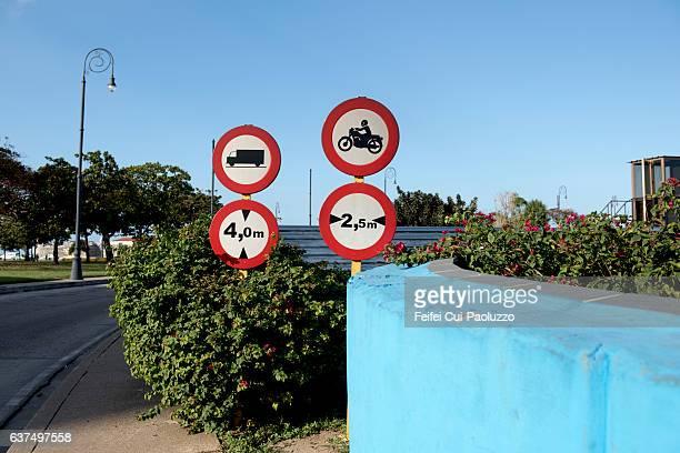 Four warning road signs at Prado of Havana in Cuba
