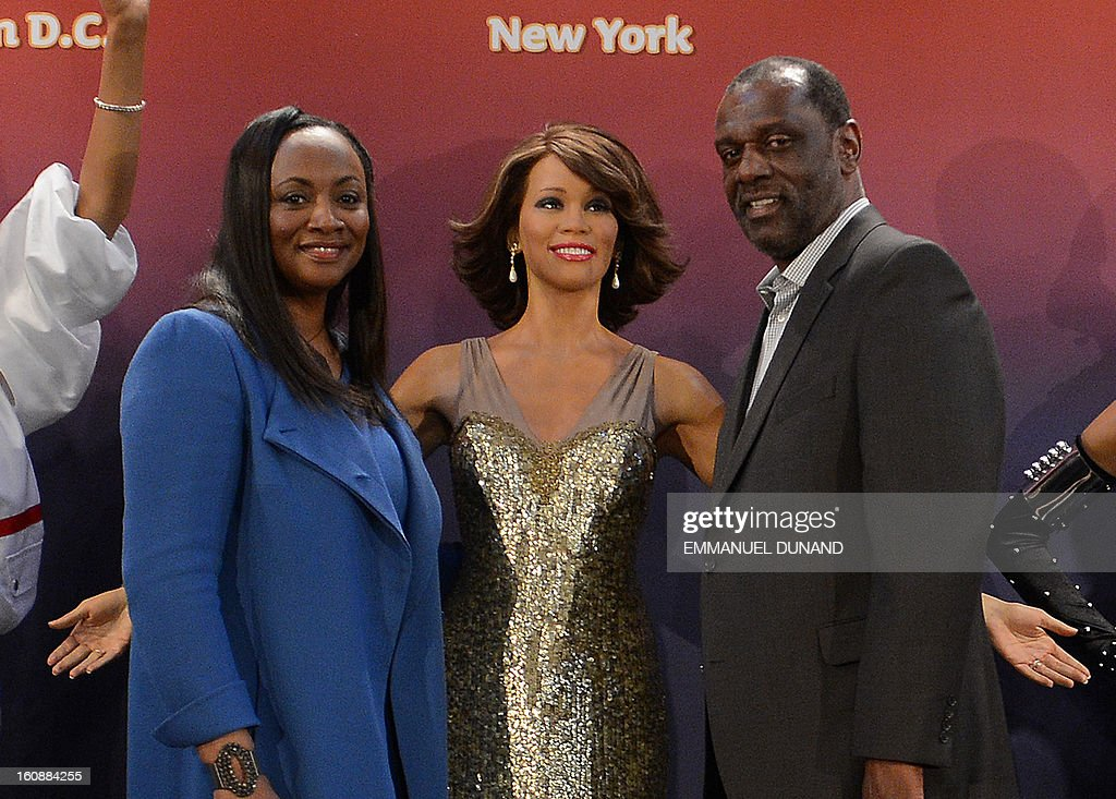 Four wax figures of late US singer Whitney Houston are unveiled at Madame Tussauds New York in presence of her brother Gary (R) and his wife Pat, in New York, February 7, 2013. The new wax likenesses, representing Houston in four different points of her life, were unveiled in front of some of her family members before being individually installed in each of the four US-based Madame Tussauds attractions in New York, Washington DC, Los Angeles and Las vegas. AFP PHOTO/Emmanuel Dunand