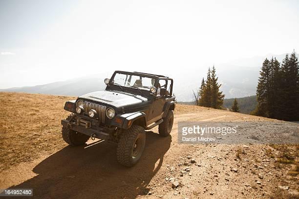 Four wheel drive vehicle on summit.