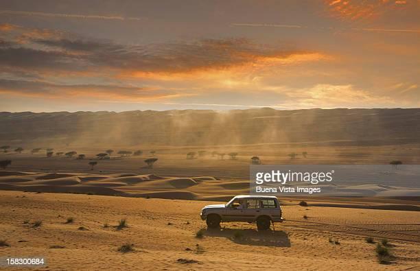 Four wheel driving in a desert