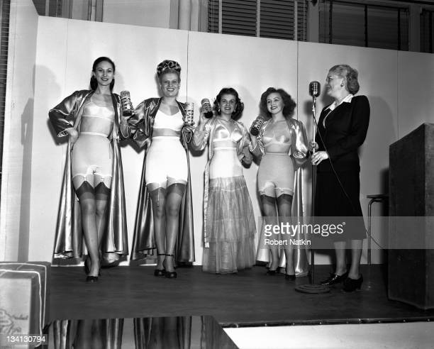 Four women exhibit the latest in fashionable women's lingerie onstage Chicago 1952
