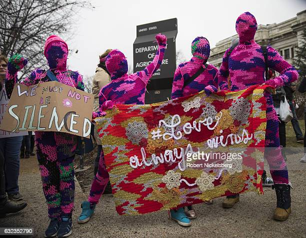 Four women from New York City wear knitted body suits while attending the Women's March on Washington on January 21 2017 in Washington DC
