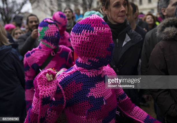 Four women from New York City wear knitted body suits while attending the Women's March on Washington on January 21 2017 in Washington DC President...