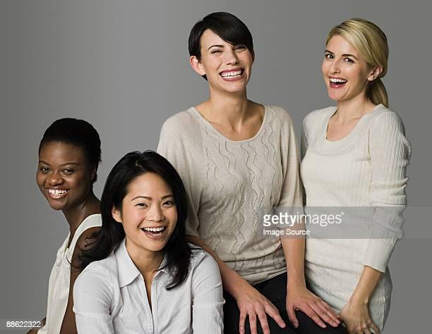four women laughing - vier personen stock-fotos und bilder