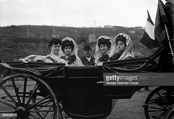 Four women ride in a horsedrawn carriage in San Sebastian Spain A man wearing a hat can be seen in the background ca1908