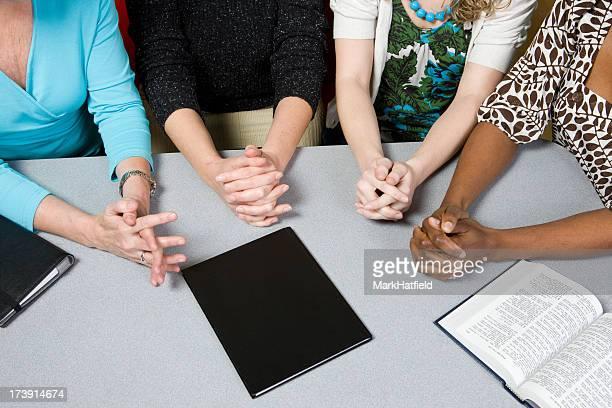 Four Women Share In Prayer