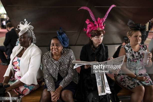 Four women take a break on the first day of races at Ascot Racecourse on June 18 2019 in Ascot England The fiveday meeting is one of the highlights...