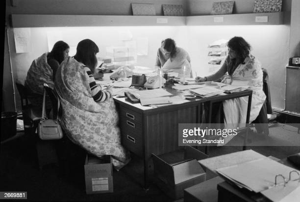 Four women working in an office in Bond Street London during the power cuts of 197374 which were caused by the miners' strike Luckily for these women...
