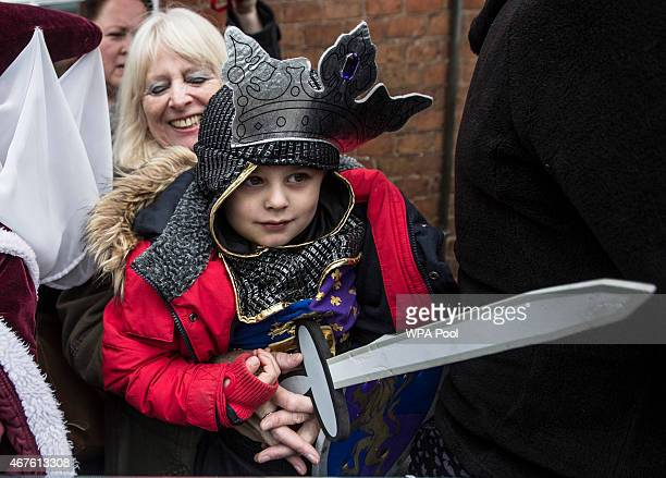 Four year old Torin Weston from Leicester dressed as Richard III waits with his grandmother outside Leicester Cathedral for the reinterment ceremony...