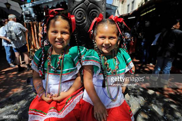 Four year old twins Jazmin and Sarah Chavez from San Bernardino California attend Cinco de Mayo festivities on May 5 at El Pueblo de Los Angeles...