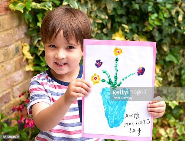 four year old with mothers day card - mothers day card ストックフォトと画像