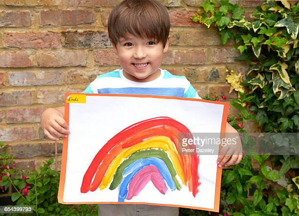 Four year old with rainbow painting