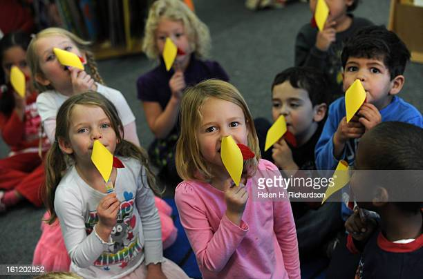 Four year olds in the class of Cynthia Lacey show off the hand made turkey beak they made out of construction paper The kids are from left to right...