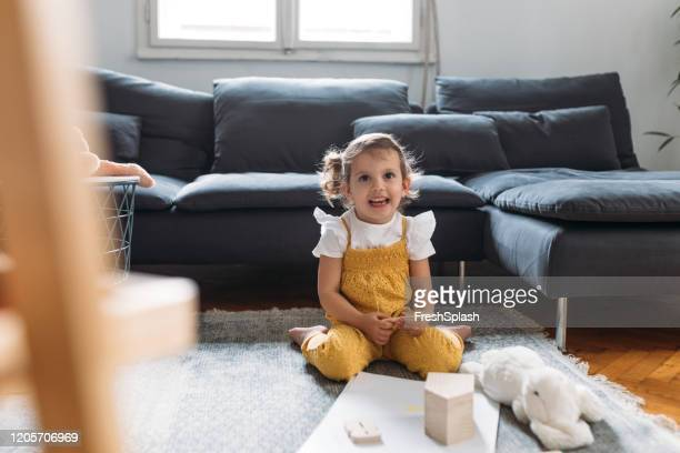 four years old girl enjoying at home - 4 5 years stock pictures, royalty-free photos & images