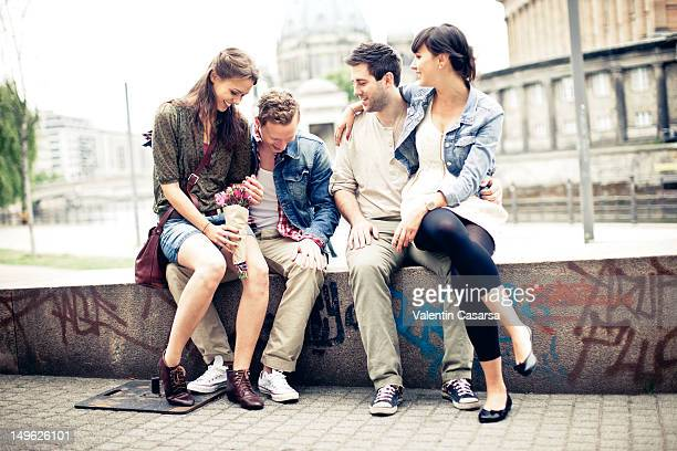 Four young adults in city