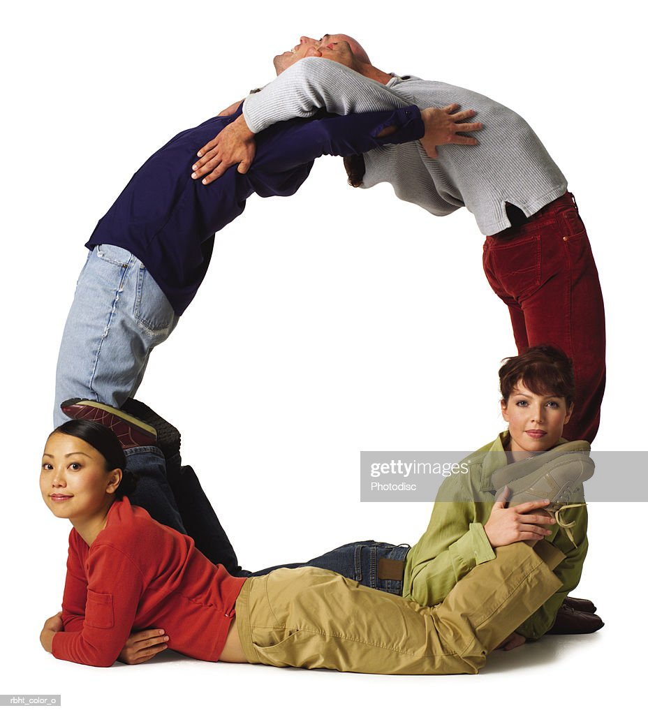 four young adults in colorful clothes create the letter O : Stock Photo