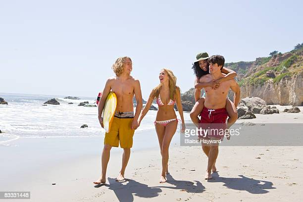 four young adults on beach