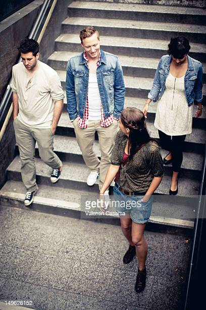 Four young adults walking down stairway